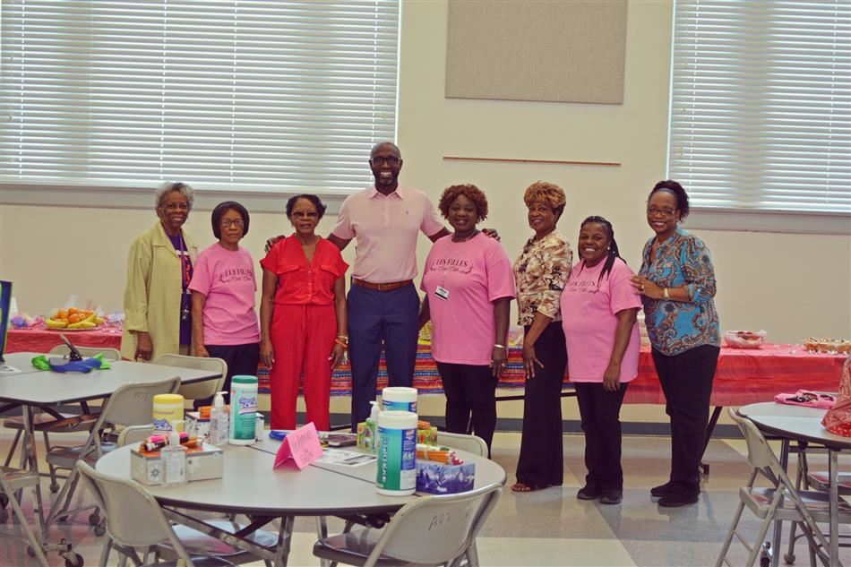 The Ladies of Les Filles Civic & Social Club recognize the teachers and staff of the A. Quinn Jones Center